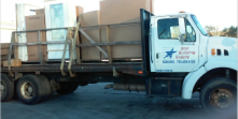 Truck loaded to deliver an Anderson Window & Exterior Door to an new home for a HBA Builder Member