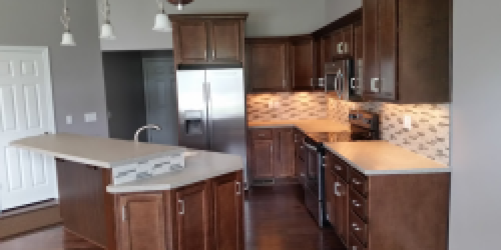 Picture of kitchen in condo for sale in 2015 Parade of Homes.  We have another house ready for brick.  Contact us for new construction or remodeling at Burkholder Construction LLC.
